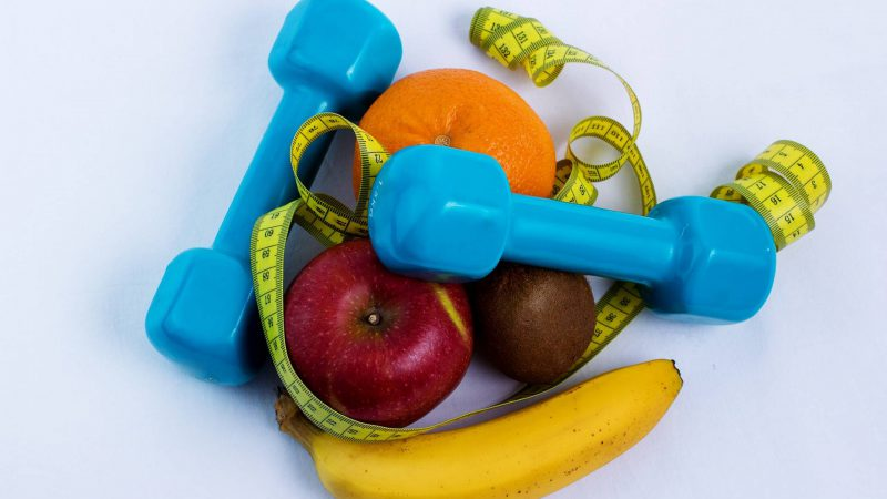 Dumbell and fruit