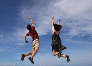 2 teenagers jumping