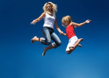 Woman and girl jumping in the air