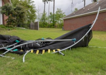Trampoline twisted and mangled after storm.