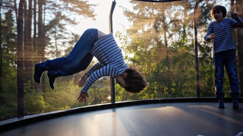 Boy doing flips on trampoline