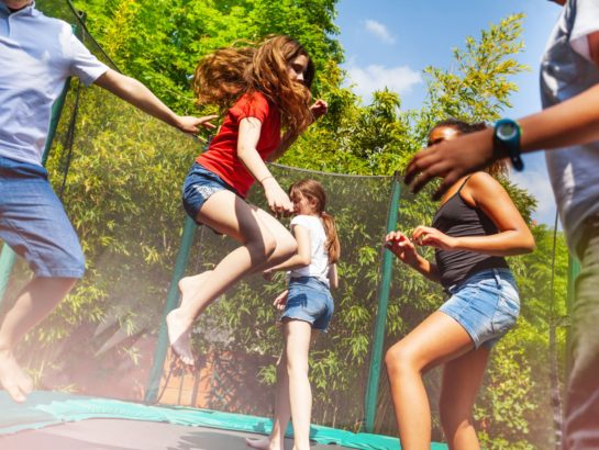 Boys and girls enjoying jumping on the trampoline