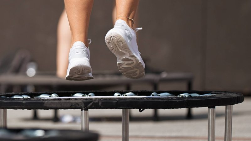 Feet jumping on fitness trampoline